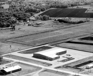 The Pembina plant is shown in this aerial photo shortly after it opened in late 1963. It is located within a stone's throw of the United States- Canadian border and has always completed coaches started elsewhere.